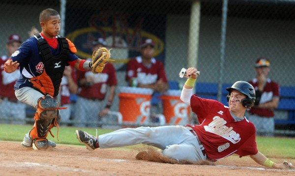 Maine District 3's Ryan Brookings slides safely into home plate before Asia-Pacific catcher Virolanson Secharmidal can apply the tag in the sixth inning of their Senior League World Series game at Mansfield Stadium on Monday evening.
