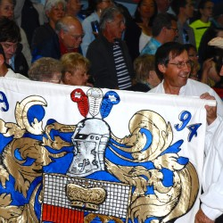 Members of the Roy family hold their banner at the annual re-enactment of the landing of the first Acadians in Madawaska.
