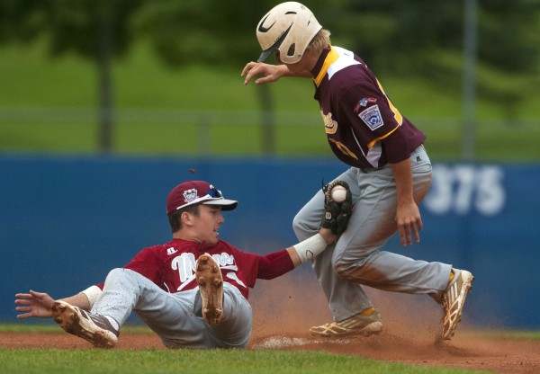 USA Southeast's Benjamin Marotske (right) makes it safely to second before Bangor's Kyle Stevenson can make the tag during their Senior League World Series game Wednesday at Mansfield Stadium in Bangor.