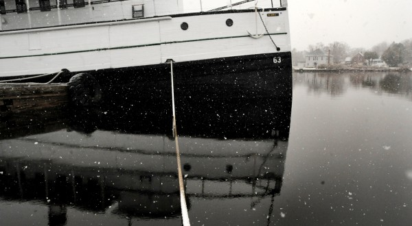Snow blanketed the Moosehead Lake region while the steamship Katahdin is tied up at a dock.