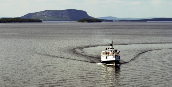 The steamship Katahdin cruises on Moosehead Lake with Mount Kineo in the background.
