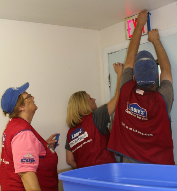 Lowe's employees spent much the day Thursday at the Sister Mary O'Donnell Homeless Shelter in Presque Isle, painting and performing other maintenance as part of their annual Lowe's Heroes program.