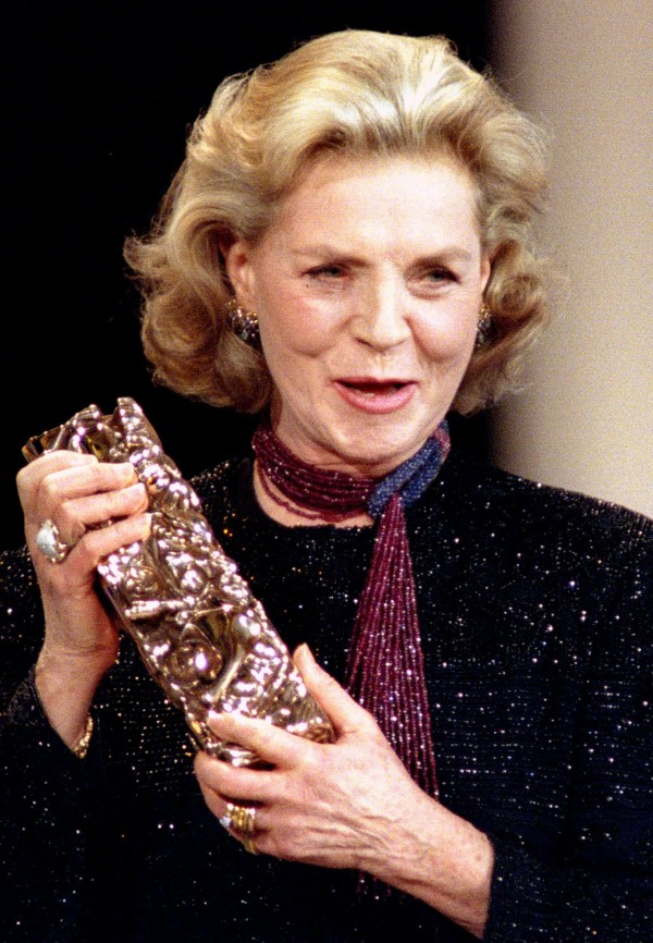U.S. actress Lauren Bacall poses with the Cesar award she received for her career at the French Film Industry awards ceremony in Paris, in this file picture taken March 2, 1996.