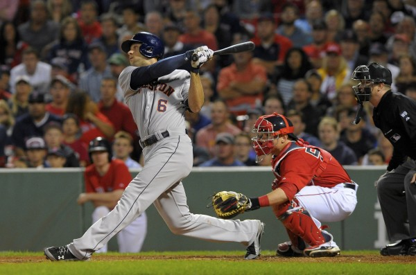 Houston's Jake Marisnick hits a two-run ground-rule double during the 10th inning against the Boston Red Sox at Fenway Park in Boston Friday night.