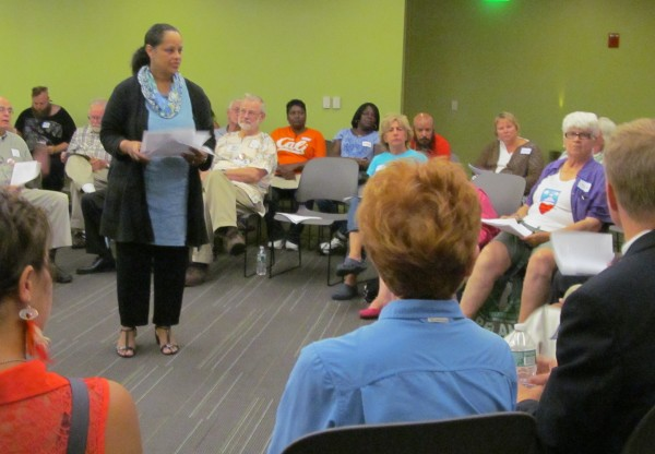 Rachel Talbot Ross, head of the Portland branch of the NAACP, on Tuesday night welcomes nearly 120 attendees to a community discussion about Portland's response to recent events in Ferguson, Missouri. The event was held at the Portland Public Library.