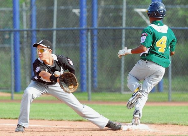 Connecticut first baseman Brad Burney gloves a throw but not before Latin America's Mairion Brunken safely reaches during Senior League World Series action at Mansfield Stadium in Bangor Tuesday afternoon.