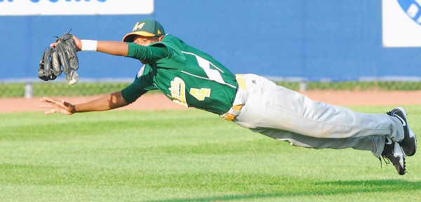 Latin America left fielder Mairion Brunken dives but can't come up with a line drive hit by a Connecticut batter during their Senior League World Series game Tuesday at Mansfield Stadium in Bangor.