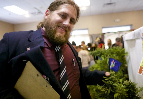 Paul McCarrier of Medical Marijuana Caregivers shows a cannabis plant at the Home Grown Maine Medical Marijuana Trade Show, a conference designed to teach individuals how to grow medical marijuana Saturday in Bangor.