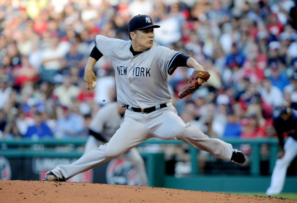 New York Yankees starting pitcher Masahiro Tanaka pitches during the second inning against the Cleveland Indians at Progressive Field in this July 2014 file photo.