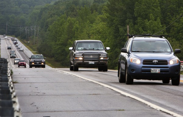 Traffic travels on Wednesday on Route 1A in Dedham near the Lucerne Inn.