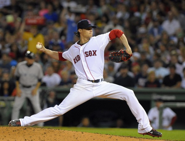 Boston Red Sox pitcher Clay Buchholz pitches during the third inning against the New York Yankees on Sunday at Fenway Park.