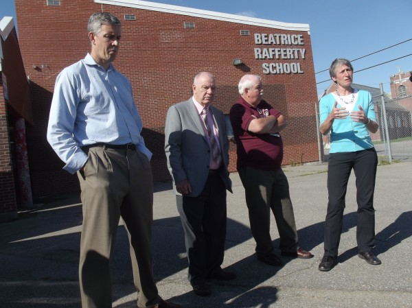 U.S. Secretary of Education Arne Duncan (from left), Maine Indian Education Superintendent Ron Jenkins, principal Mike Chadwick and U.S. Secretary of the Interior Sally Jewell speak with reporters after a tour of Beatrice Rafferty School at Pleasant Point on Monday.
