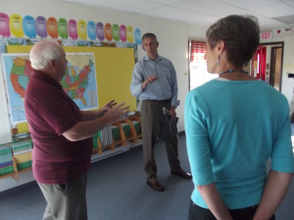 Mike Chadwick (from left), principal of Beatrice Rafferty School at Pleasant Point, speaks with U.S. Secretary of Education Arne Duncan and U.S. Secretary of the Interior Sally Jewell during a tour of the school on Monday.