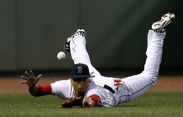 Boston right fielder Mookie Betts dives for a ball against the Los Angeles Angels during the fourth inning at Fenway Park in Boston Tuesday night.
