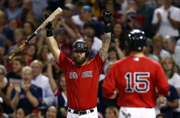 Boston Red Sox first baseman Mike Napoli (left) celebrates as Dustin Pedroia scores against the New York Yankees during the third inning of Friday night's game at Fenway Park. The Red Sox won 4-3.