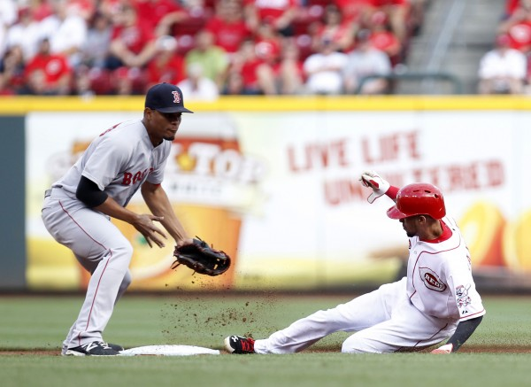 Cincinnati's Billy Hamilton steals second base while Boston Red Sox shortstop Xander Bogaerts fields the throw during the first inning at Great American Ball Park in Cincinnati Tuesday night.