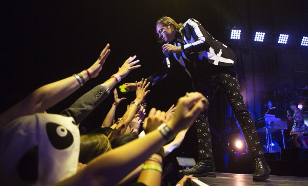 Arcade Fire's Win Butler sings to the crowd during their show Wednesday at the Darling's Waterfront Pavilion in Bangor.