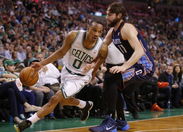 Boston Celtics guard Avery Bradley (left) drives to the basket against Charlotte Bobcats forward Josh McRoberts at TD Garden in Boston in this April 2014 file photo.