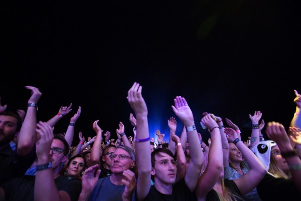 Concertgoers clap their hands during the Arcade Fire show Wednesday at the Darling's Waterfront Pavilion in Bangor. Opening bands were Antibalas and Dan Deacon.