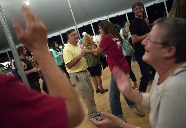 Ralaud Roy (left) dances with Mindy Daigle during the 2014 American Folk Festival.