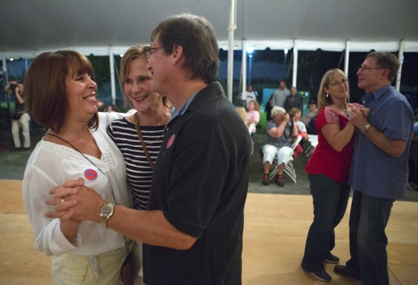 Tammy Lunn (from left), Kathy Rockwall, and Greg Lunn dance during the 2014 American Folk Festival.