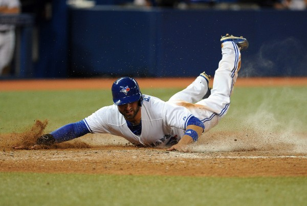 Toronto's Kevin Pillar slides safely into home plate against the Boston Red Sox in the seventh inning Wednesday night in Toronto.
