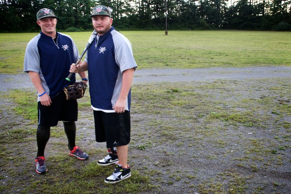 Josh Wege (left) and Rick Will of the Wounded Warrior Amputee Softball Team stand in the parking lot of The Ballpark in Old Orchard Beach on Thursday night.