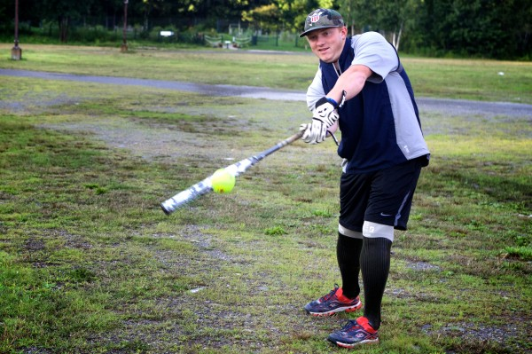 Josh Wege, 24, of the Wounded Warrior Amputee Softball Team takes a few practice swings on Thursday evening in Old Orchard Beach.