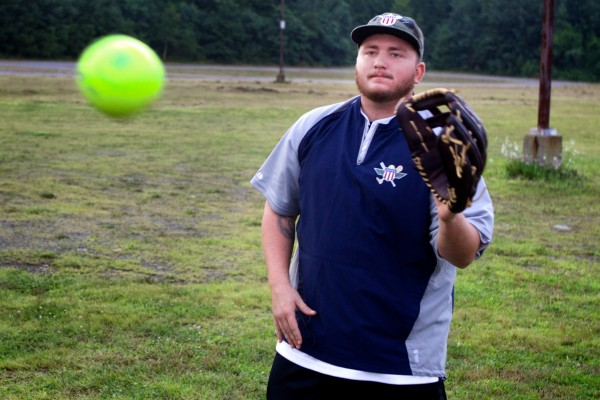 Rick Wilk, 23, of the Wounded Warrior Amputee Softball Team plays a little catch with a teammate on Thursday evening in Old Orchard Beach. Wilk is an Army veteran who lost his leg when he was hit by a drunk driver while on duty at Fort Bragg in North Carolina in 2010.