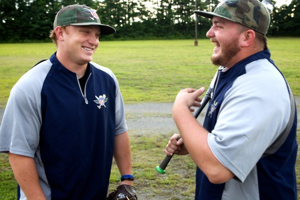 Josh Wege (left) and Rick Wilk of the Wounded Warrior Amputee Softball Team stand in the parking lot of The Ballpark in Old Orchard Beach on Thursday night.