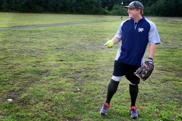Josh Wege, 24, of the Wounded Warrior Amputee Softball Team plays catch with a teammate on Thursday evening in Old Orchard Beach. Wege is a Marine veteran who lost both legs below the knees in Afghanistan in 2009.