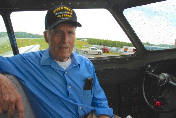 World War II veteran and B-17 pilot Edmond Theriault reminisces about his days flying in the war after taking a ride in a vintage plane on Thursday in Frenchville.