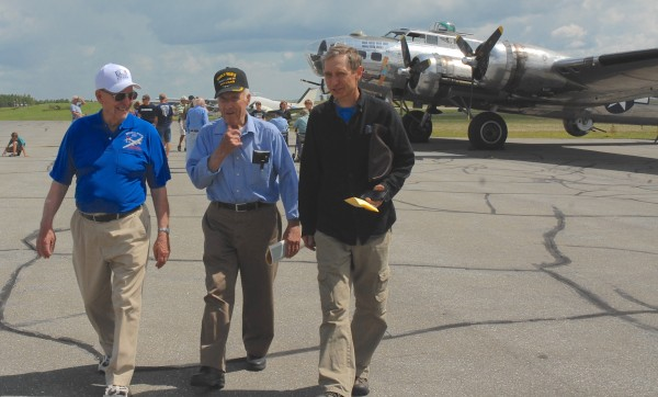 World War II veterans Alberie Nadeau (left) and Edmond Theriault (center) chat with Northern Arookstook Airport Manager Dave Fernald before boarding the Sentimental Journey B-17 bomber on Thursday in Frenchville.