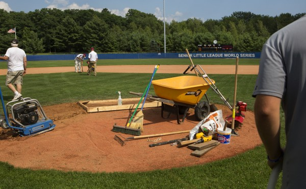 The new scoreboard is seen while grounds crew members work to ready the field at Mansfield Stadium in Bangor Tuesday.