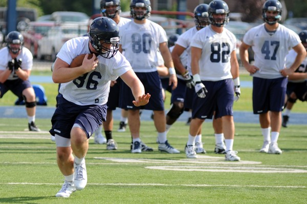 Max Andrews of the University of Maine runs a route during Monday's practice at Morse Field in Orono.