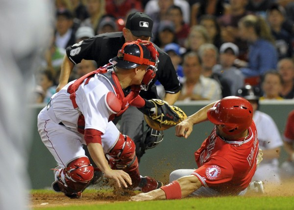 Boston Red Sox catcher Christian Vazquez tags out Los Angeles Angels' Albert Pujols during the eighth inning at Fenway Park in Boston Monday night.