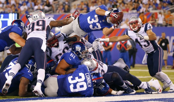 New York Giants running back Peyton Hillis (33) dives in for touchdown during the first half against the New England Patriots at MetLife Stadium in East Rutherford, New Jersey, Thursday night.
