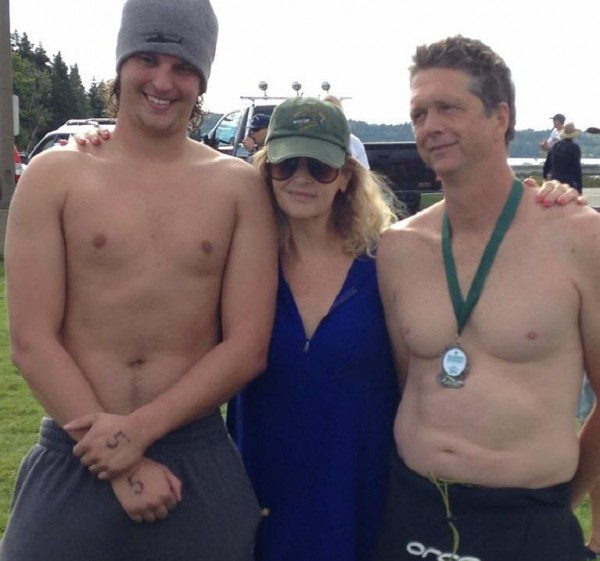 TV star and Islesboro summer resident Kirstie Alley congratulates two of the finishers of Saturday's Islesboro Crossing, a 3-mile swim fundraiser for LifeFlight of Maine.