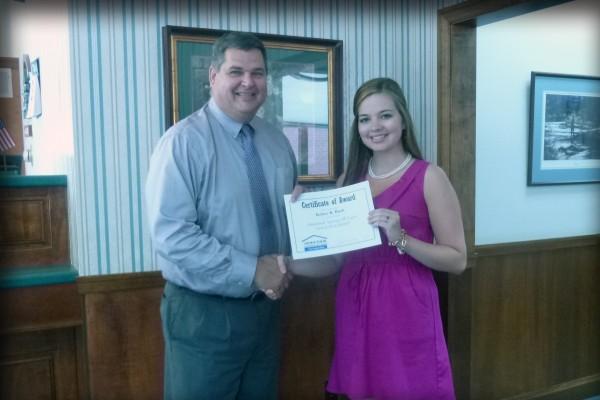 Aroostook Savings & Loan President John Swanberg awards and congratulates $4,000 Scholarship recipient Kelsey Buck.