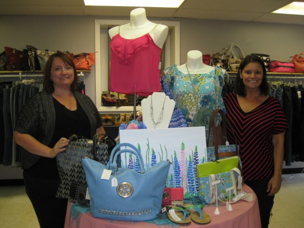 Roxanne Noddin and Crystal Jones, owners of Generations Boutique, 153 State St. in Brewer, show off a display they created that features some of the items available at the shop.