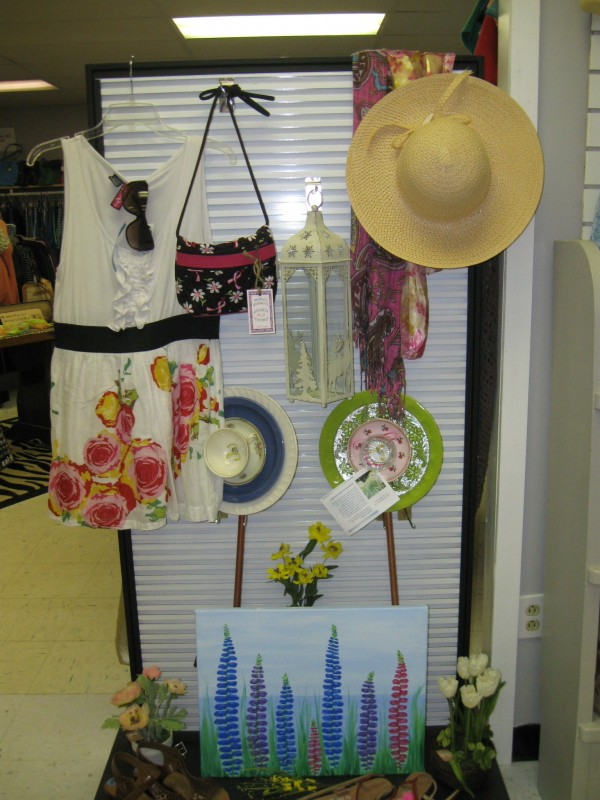 A display of merchandise available at Generations Boutique in Brewer features a summer flower theme.