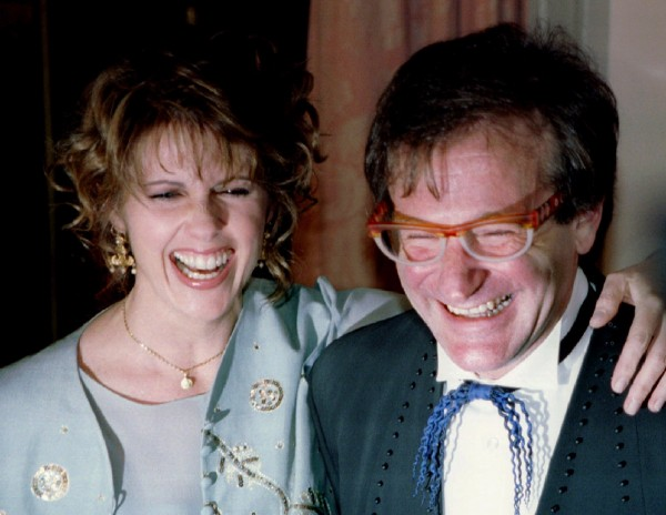 Actress Pam Dawber shares a laugh with actor Robin Williams as they pose for photographers before the annual American Museum of the Moving Image Tribute dinner in New York in this Feb. 23, 1995 file photo. Williams and Dawber starred in the TV show &quotMork and Mindy.&quot