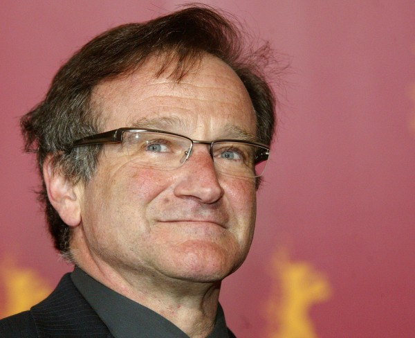Robin Williams poses during a photocall to present his new movie &quotThe Final Cut&quot as part of the festival competition at the 54th Berlinale International Film Festival in Berlin in this picture taken Feb. 11, 2004.