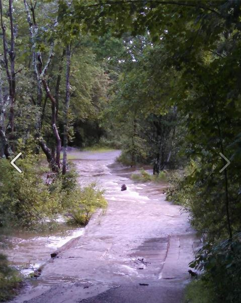 A private drive off Tuttle Road in Pownal is flooded after Wednesday's storm.