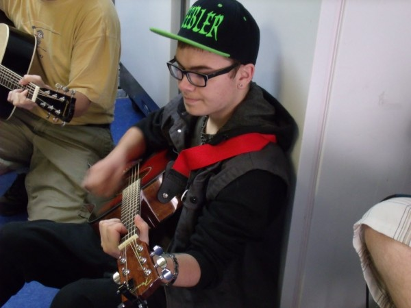 Shaw House resident Jesse Davis plays guitar during a rendition of Guns N' Roses' &quotSweet Child of Mine&quot at a Wednesday morning jam session. He hopes to pursue mixing and electronic music in the future.