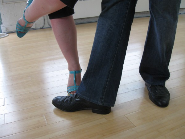 Feet belonging to tango dancers Deb Rollins and Daniel Sullivan pause briefly as they practice steps of the dance at Noh Way School in Bangor.