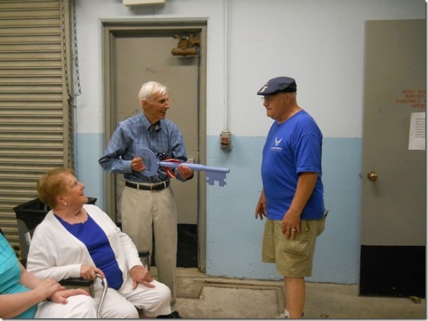 Photo courtesy of Maine Air Museum Bill Zoidis (left) former owner of Pilots Grill, which operated for many years on outer Hammond Street in Bangor, accepts the key to the Maine Air Museum in Bangor from museum Directer Chuck Byrum (right) during a ceremony at the museum on Aug. 2.
