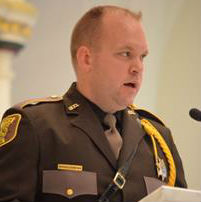 Deputy Patrick Ferriter of the Cumberland County Sheriff's Department serves as a reader during 2013 Blue Mass at the Cathedral of the Immaculate Conception in Portland.