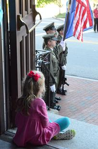 A young girl watches as honor guards line the steps of the Cathedral of the Immaculate Conception in Portland prior to the 2013 Blue Mass at the Cathedral of the Immaculate Conception in Portland.