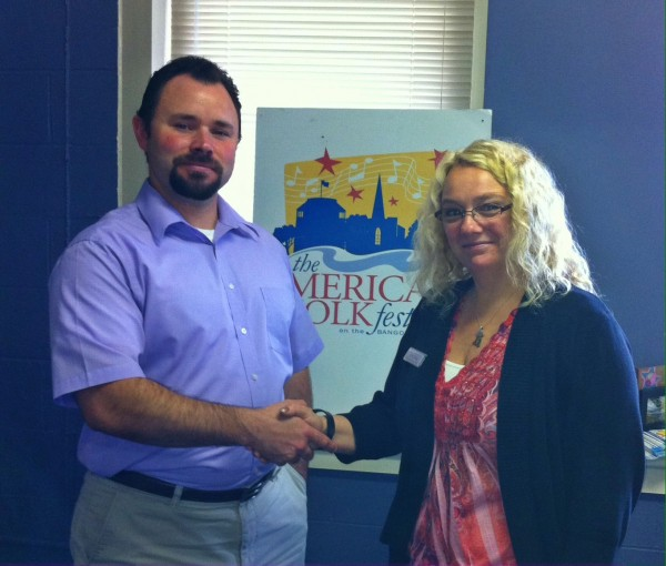 Eric Hunter of the American Folk Festival with Carrie Bishop, assistant branch manager, Camden National Bank in Bangor.